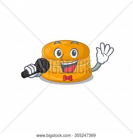 Cute Orange Macaron Sings A Song With A Microphone