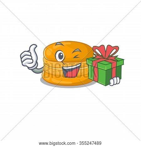Smiley Orange Macaron Cartoon Character Having A Gift Box