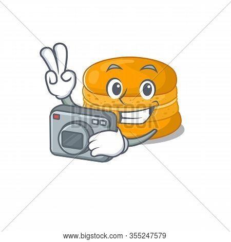 Orange Macaron Mascot Design As A Professional Photographer With A Camera