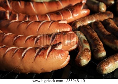 A Lot Of German Bratwurst On Barbecue Grill