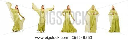 The young woman in elegant long green dress isolated on white
