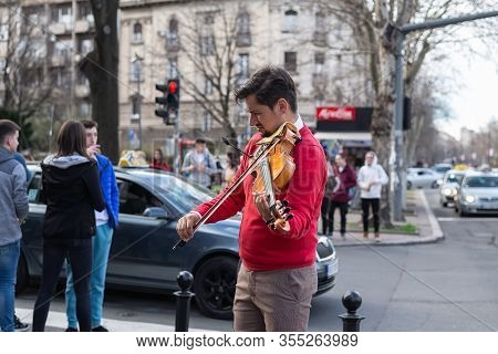 Belgrade,serbia-11.03.2020. Street Musician Lifestyle. Man Musician Playing On Street. Violinist Mus