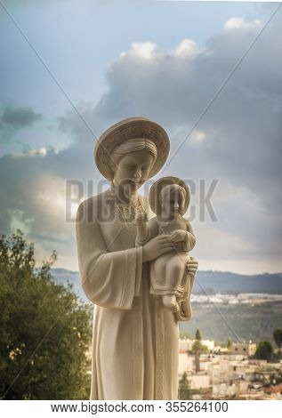 Abu Ghosh, Israel, January 29, 2020: The Statue Our Lady Of La Vang With A Baby In Her Arms In The G