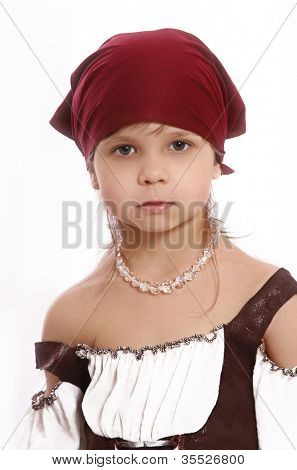 beautiful little girl in a pirate costume isolated