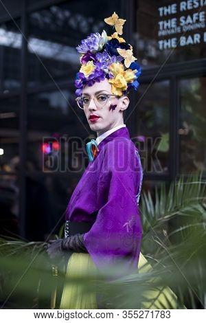 London, Uk- Febryary 15 2020: Fashionable People On The Street . Street Style. A Man In A Purple Kim