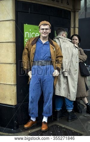London, Uk- Febryary 15 2020: Fashionable People On The Street . Street Style. Young Man In Blue Ove