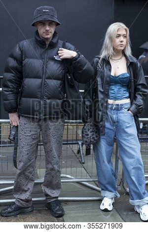 London, Uk- Febryary 15 2020: Fashionable People On The Street . Street Style. Happy Couple. Man In