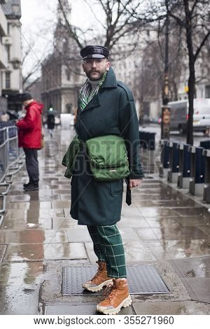 London, Uk- Febryary 15 2020: Fashionable People On The Street . Street Style. A Man In A Leather Ca