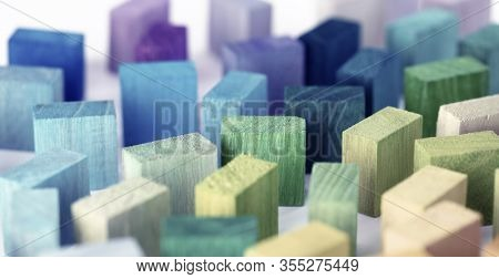 Spectrum of colorful wooden blocks.  Background image or cover for something creative or a diverse. Muted color.