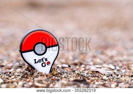 Budva, Montenegro March 07, 2020: New Pokemon Go Plus On The Beach Against The Sea. Pokemon Go Is A