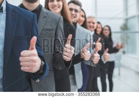 Large Group Of Young Entrepreneurs Showing Thumbs Up