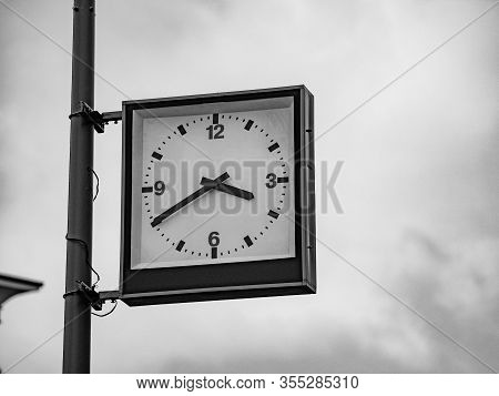 Street Clock With A Traditional Dial And Hands Arrows For Hours And Minutes. An Rectangular Boxed An