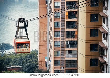CHONGQING, CHINA – MARCH 13: Cable car and buildings on March 13, 2018 in Chongqing. With 17M population, it is the most populous Chinese municipality.