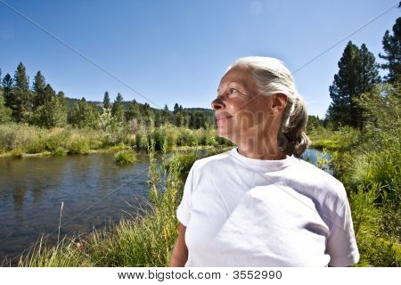Woman On River Bank