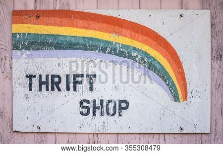 A Conceptual Recession Image Of An Old Sign For A Thrift Shop