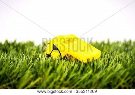 Yellow Whistle Soccer Sports On Grass Background - Penalty, Foul Or Sport Concept, Selective Focus