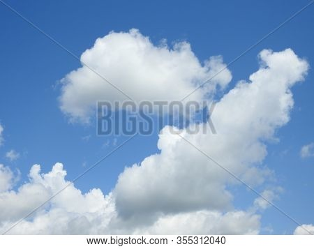 Puffy Clouds Against Blue Sky On A Sunny Day