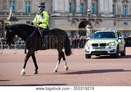 London, United Kingdom, March 8th 2020:- A Police Officer On Horseback And Police Vehicle Outside Bu