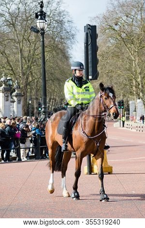 London, United Kingdom, March 8th 2020:- A Police Officer On Horse Back On The Mall Near Buckingham