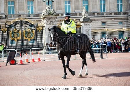 London, United Kingdom, March 8th 2020:- A Police Officer On Horse Back Outside Buckingham Palace