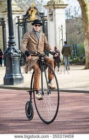 London, United Kingdom, March 8th 2020:- An Unknown Man Riding A Penny Farthing On The Mall Near Buc