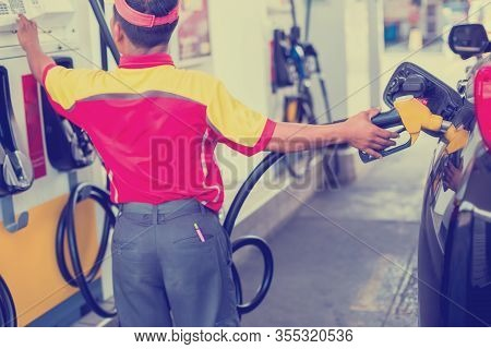 Selective Focus To Hands Refilling The Car With Fuel And Press Control Panel At The Gas  Station,