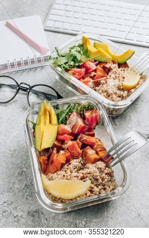 Vegetarian Healthy Meal Prep Containers . Raw Vegetables And Quinoa For Lunch On Light Workspace. Ve