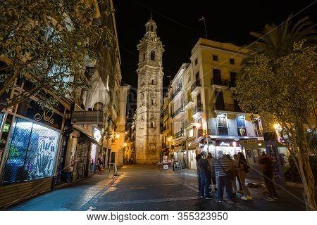 Valencia, Spain - October, 2019: Walking Night Streets Of Valencia Illuminated At Night. View Of Tor