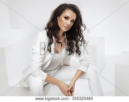 Beauty brunette posing over white background