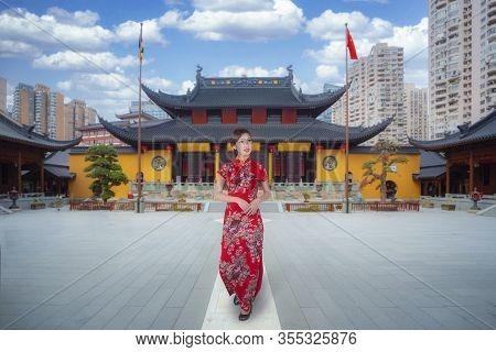 Chinese Girl Walk With Cheongsams Traditional Dress In Buddha Temple In Shanghai, Shanghai City, Chi
