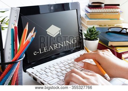 Woman Hands Using Laptop. Workplace With Computer And Books. E-learning, Online Education Concept.