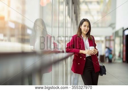 Young Office Worker Girl Holding Hot Espresso Paper Cup Leisurely Walking On Glass Wall Background T