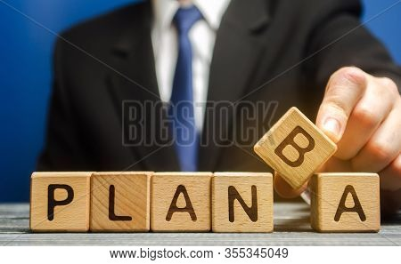 Businessman Puts Wooden Blocks With The Words Plan A And B. Strategy Planning. Business Management.