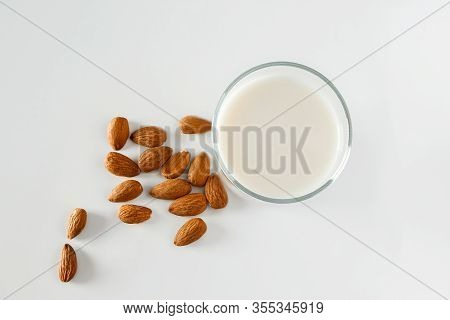 A Glass Of Almond Milk On A White Background. Lactose-free Vegetable Diet Milk. Gluten Free Almond D