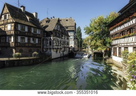 Summer Scenery In Strasbourg City, In Alsace, France. Buildings With Alsatian Architecture On Ill Ri
