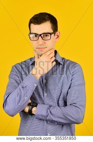 Handsome Man Wearing Glasses Touch Chin. Friendly Face Portrait Of An Unshaven Man With Glasses. Bus