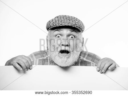 Announcement Concept. Event Announcement. Senior Bearded Emotional Man Peek Out Of Banner Place Anno