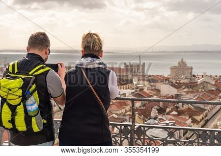 Lisbon, Portugal - 2 March 2020: Tourists Looking At The View From Elevador De Santa Justa. Arco Da