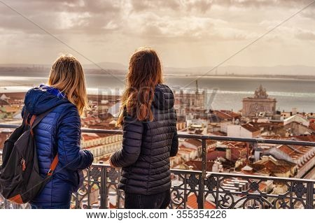 Tourists Looking At The View From Elevador De Santa Justa. Arco Da Rua Augusta In The Background.