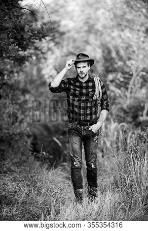 Hes A Cowboy Aint He. Man Checkered Shirt On Ranch. Cowboy With Lasso Rope. Western. Vintage Style M