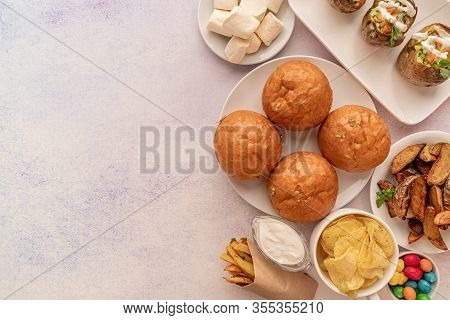 Healthy And Unhealthy Food Concept. Unhealthy Food Burgers, French Fries And Sweets Top View Flat La