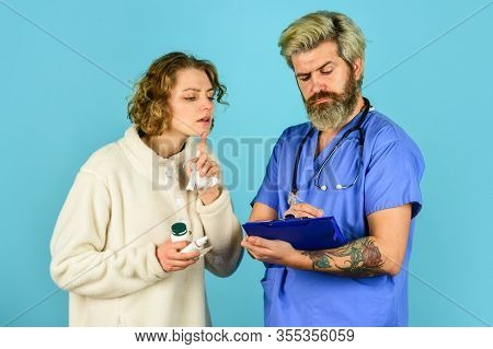 Healthcare And People. Patient And Doctor Hold Pills. Woman With Runny Nose At Nurse Consultation. D
