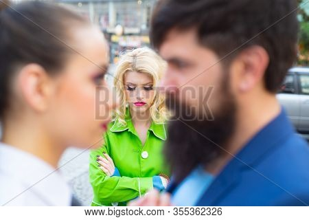Divorce Reason. Infidelity. Disloyal Man Walking With His Girlfriend And Looking Amazed At Another S