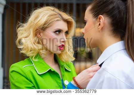 Lesbian Couple In Love On Street. Secret Love. That Others Do Not Know That Adultery