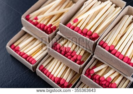 Matches In Gray Paper Boxes. Wooden Sticks With Sulfur On The Tip To Ignite The Flame.