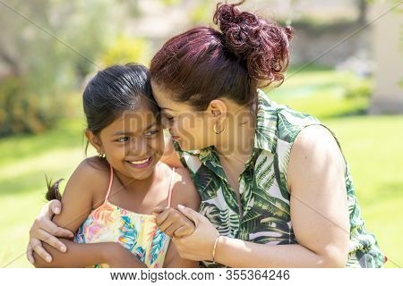 Love Between A Young Mother And Her Pretty Daughter Outdoors