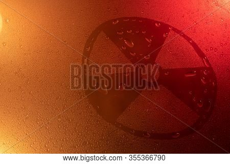 Radiation Symbol In Neon Light Background Drops Trend 2020 Color Lush Lava, Flat Lay Top View Copy S