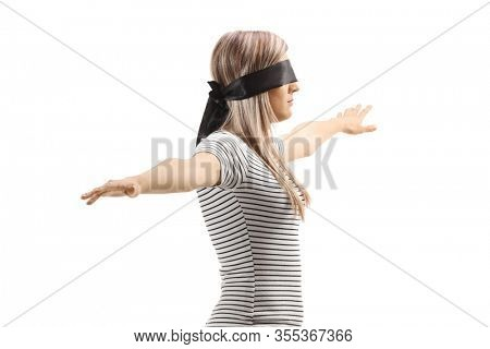 Young blond woman wearing blindfold and walking with spread arms isolated on white background