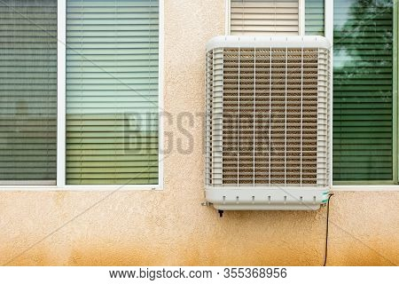 Modern Evaporative Cooler Also Known As Swamp Cooler Installed In A Window. Great Concept Image For