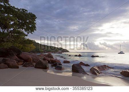 Dramatic Dusk At The Coastline Of La Dique Island, Seychelles